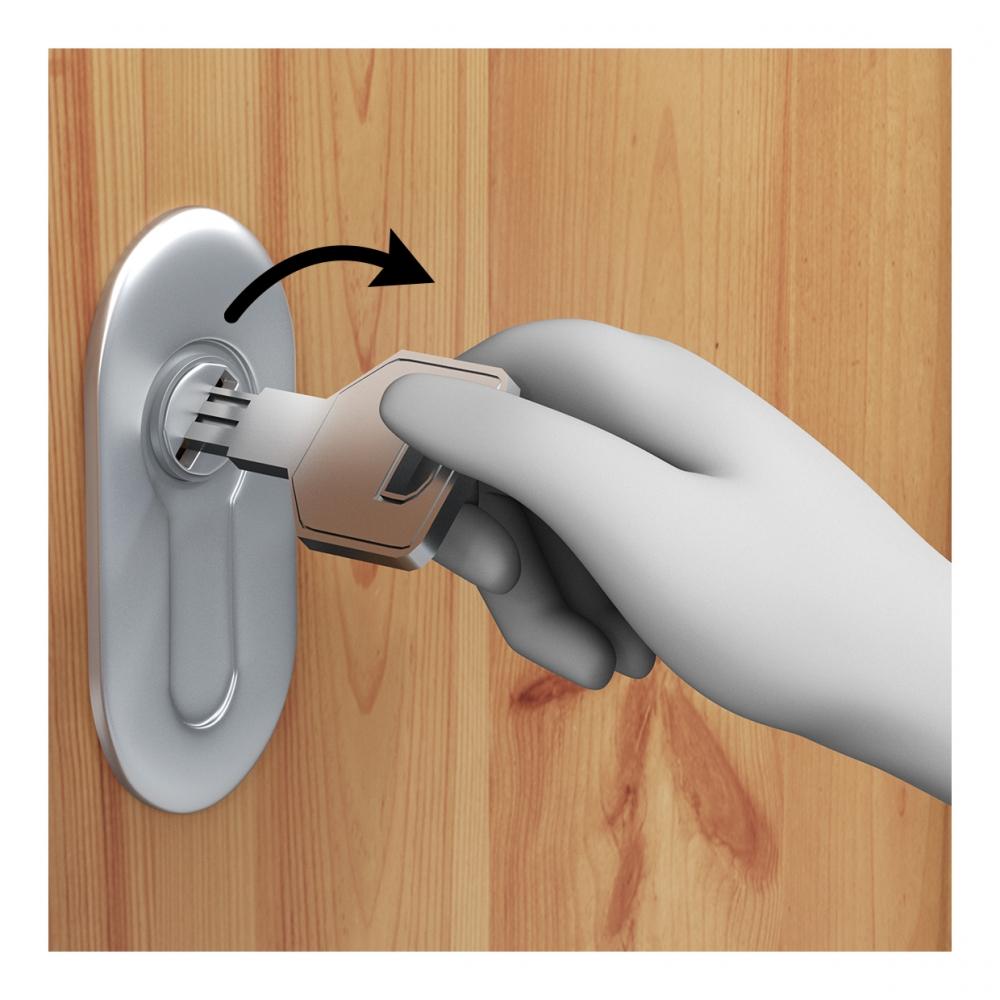 Una mano abre una cerradura con una llave