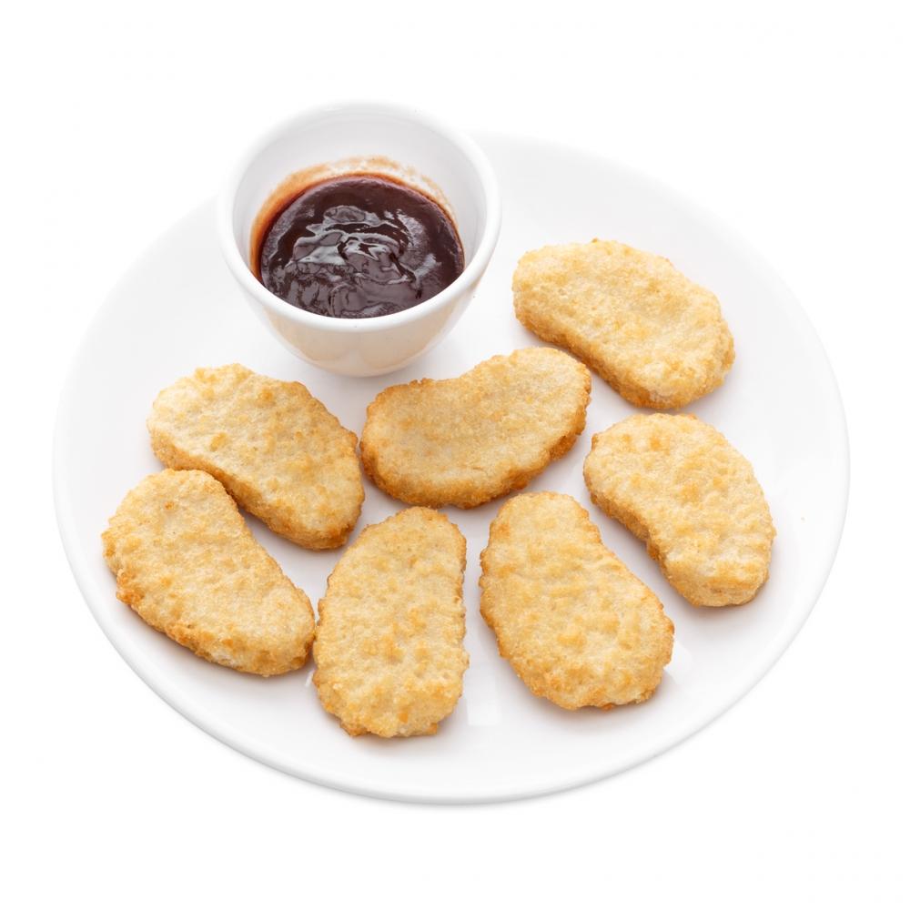 Imagen en la que se ve un plato de nuggets de pollo