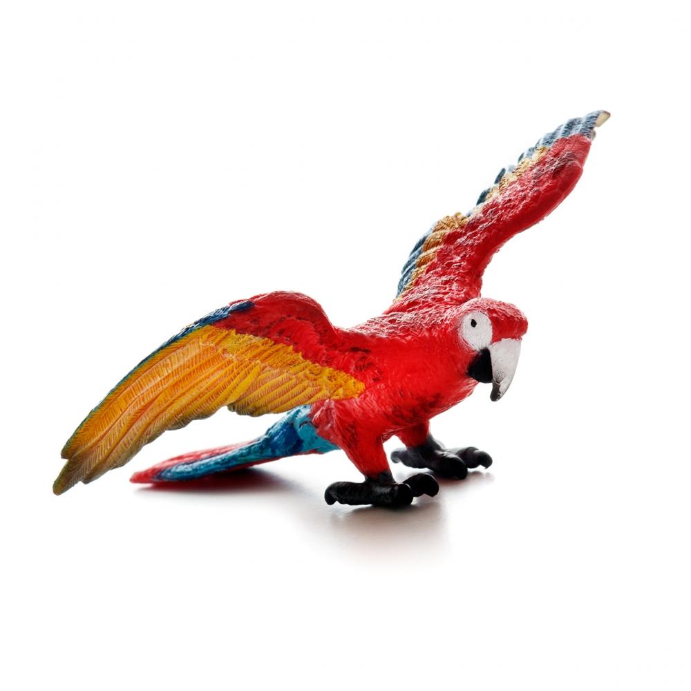 Imagen en la que se puede ver un loro con las alas abiertas