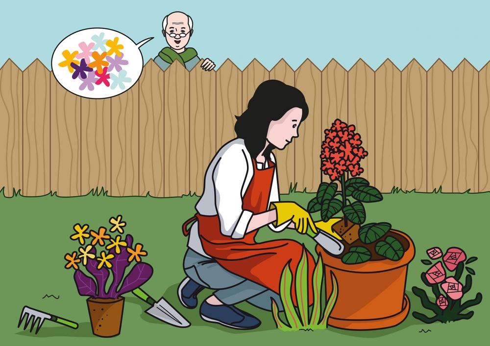 La jardinera planta flores en el jardín