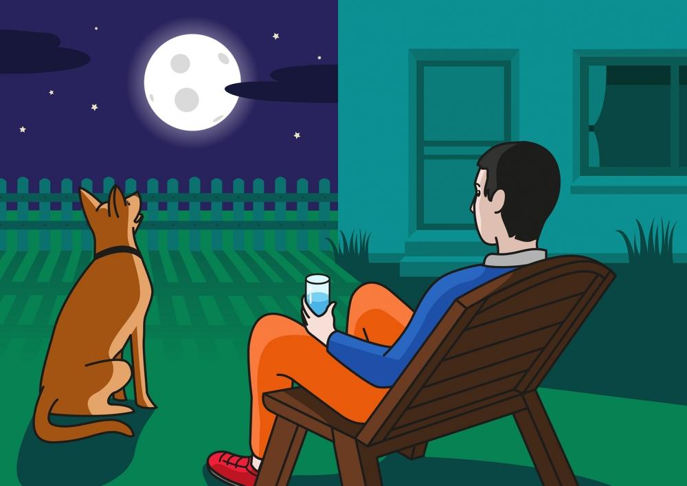En la escena, se observa a un padre y a su perro mirando la Luna desde el jardín de su casa.