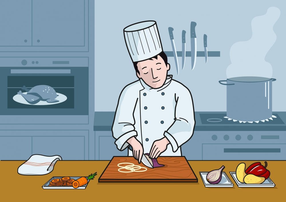 El cocinero corta la cebolla con el cuchillo