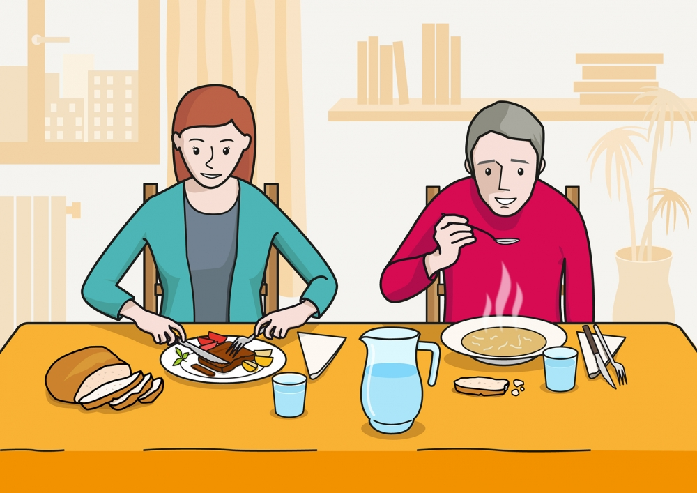 En la escena, se observa a dos personas sentadas en la mesa y comiendo en el comedor de su casa. La madre esta comiendo un trozo de carne y el padre está comiendo sopa calente.