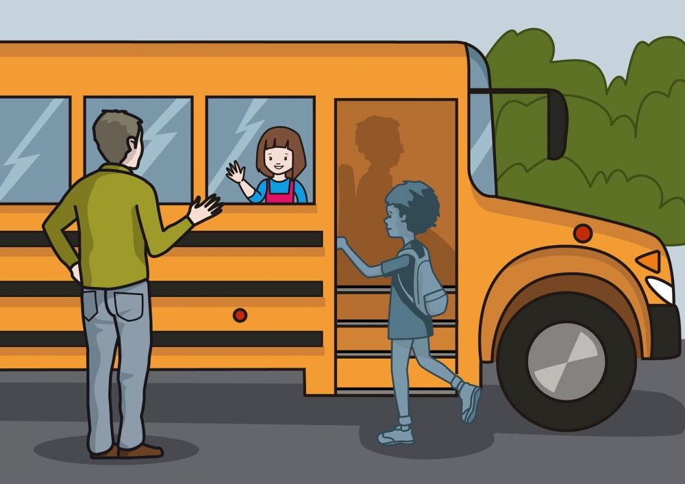 El papá despide a la niña en el autobús