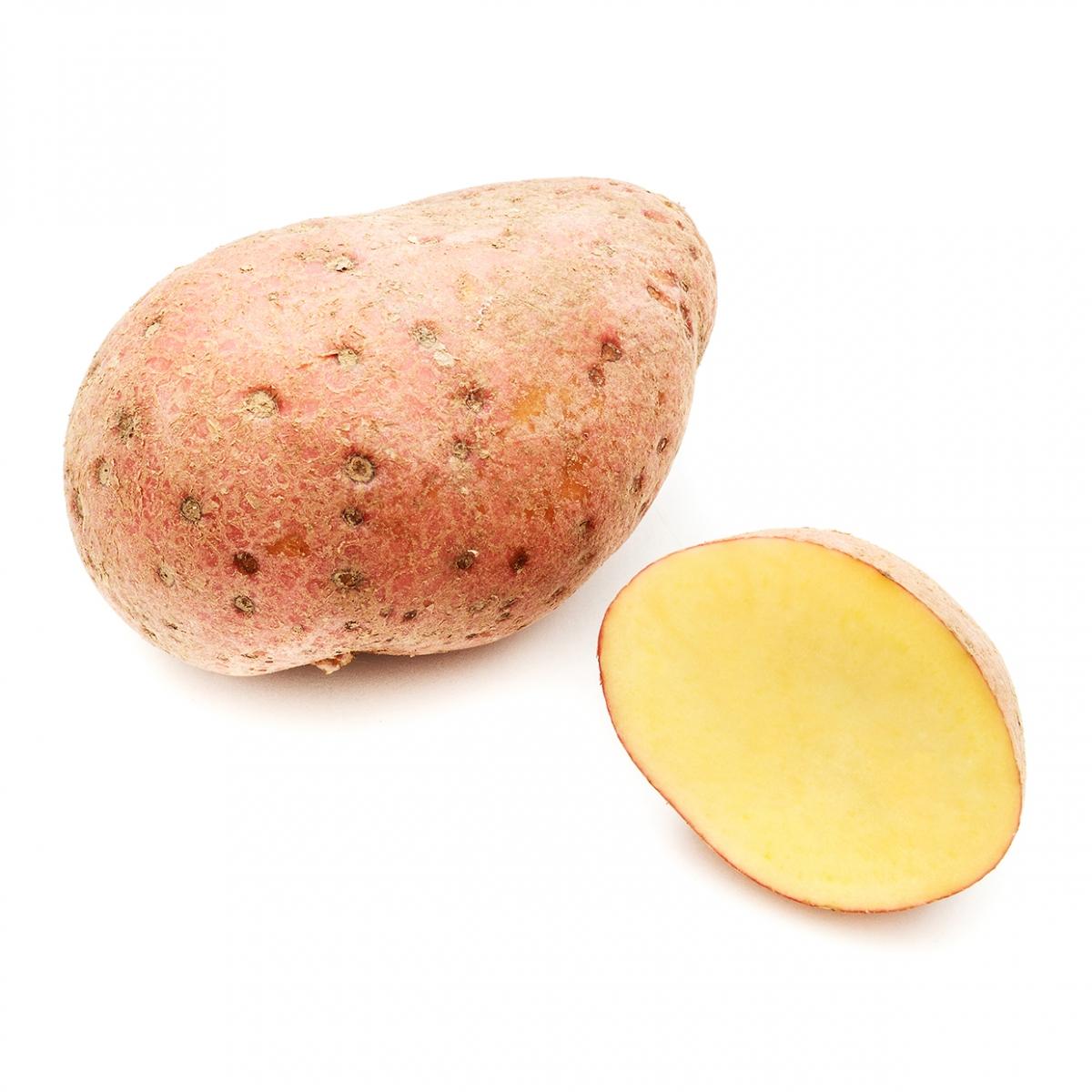 Imagen en la que se ve una patata entera y otra media a su lado