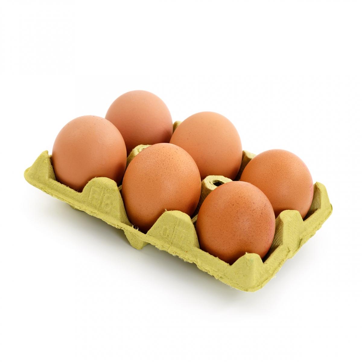 Imagen en la que se ve una huevera con 6 huevos