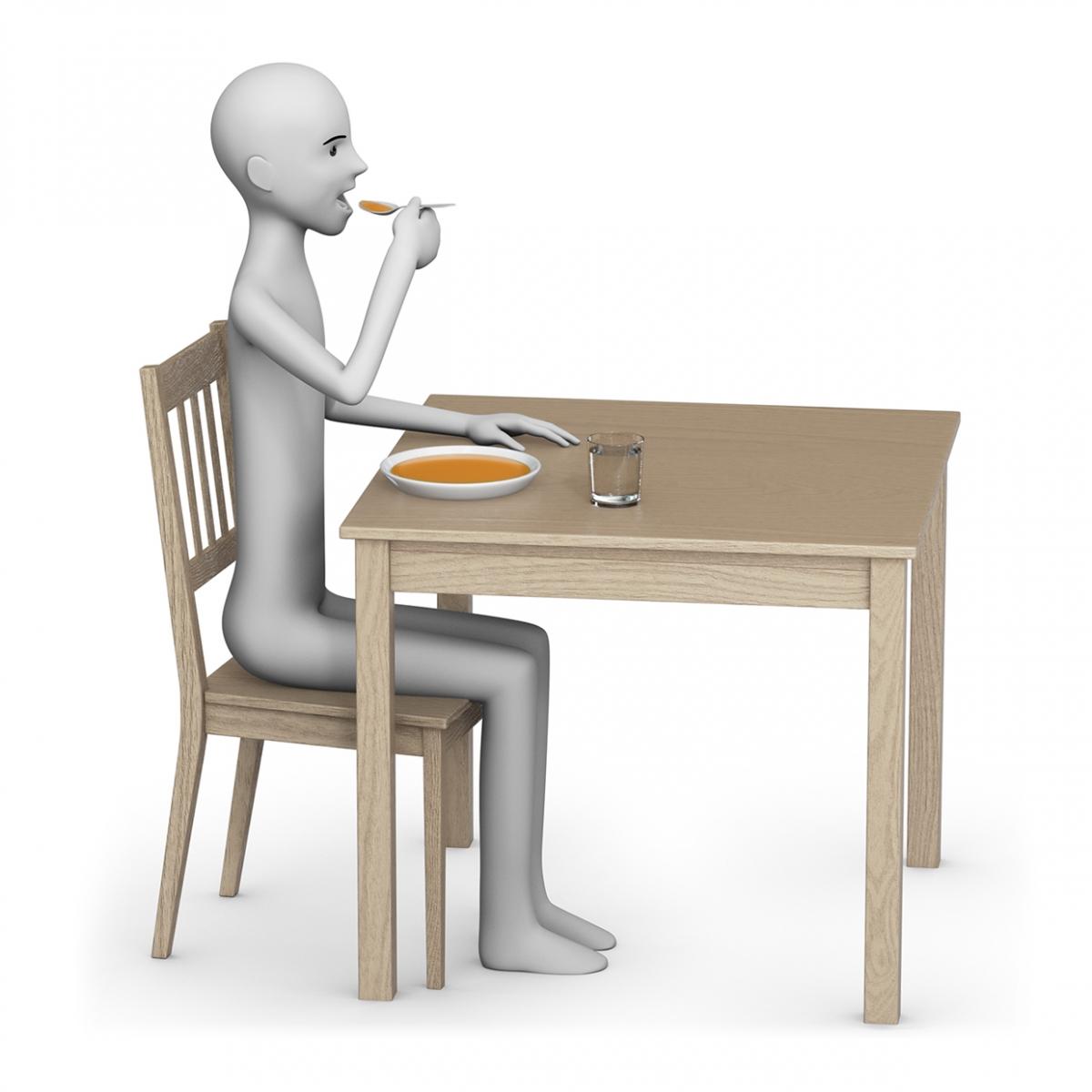 Una persona come sentada en una mesa