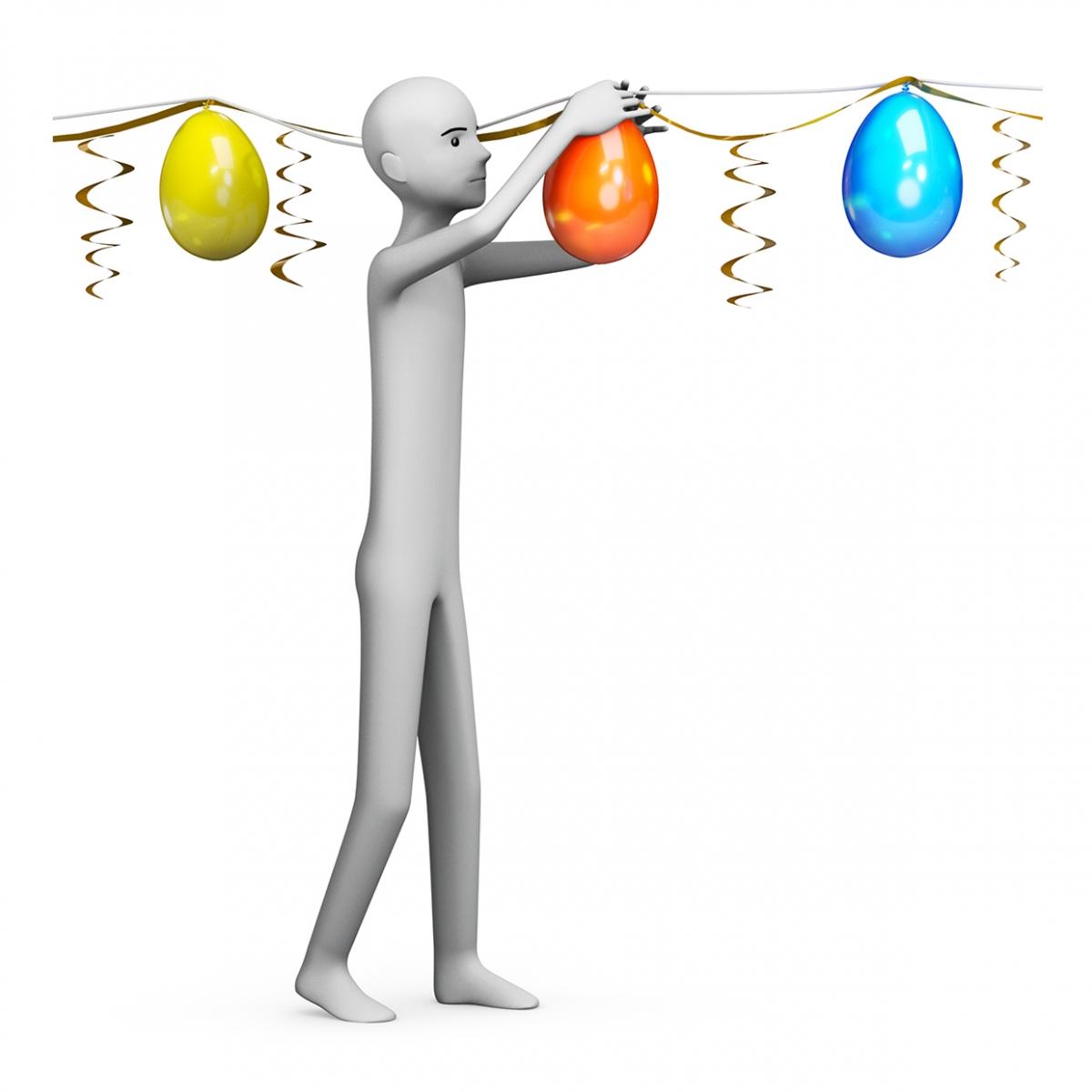 Imagen de una persona decorando con globos