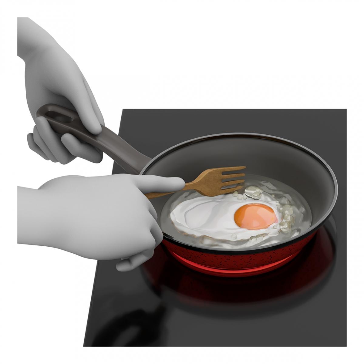 Imagen en la que se ve una mano friendo un huevo