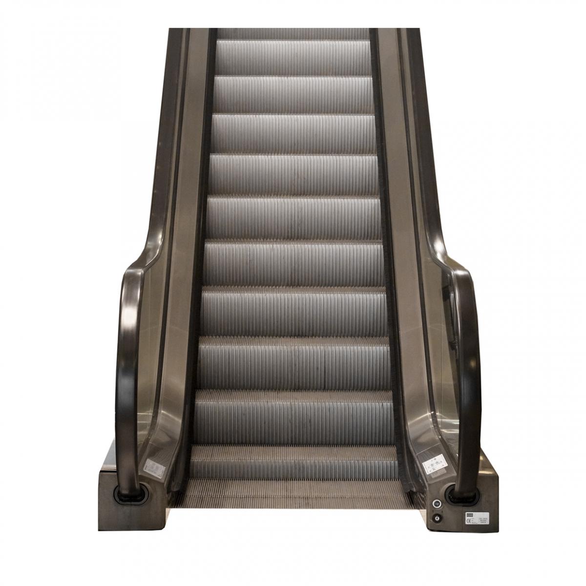 Imagen en la que se ve una escalera mecánica