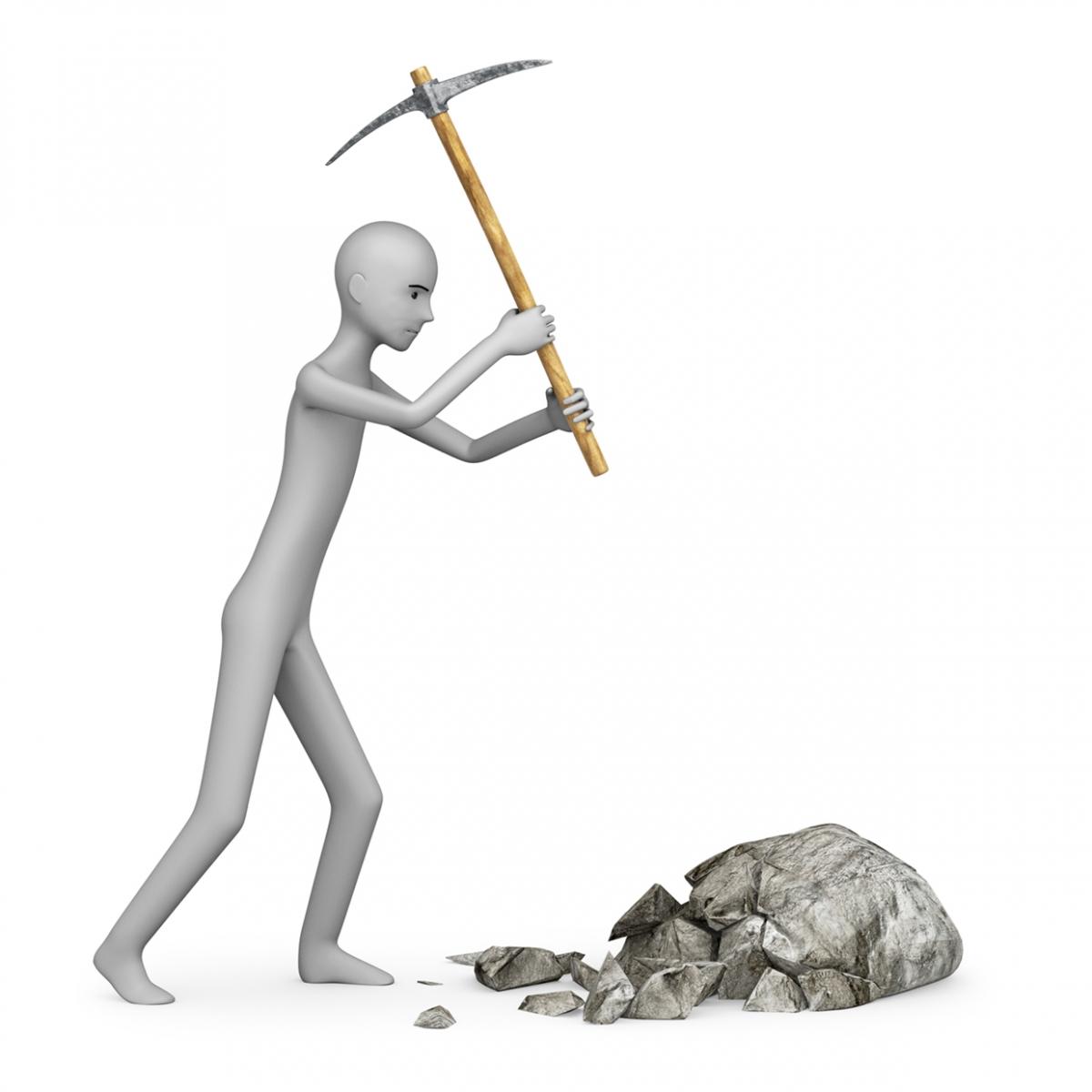 Imagen en la que se ve una persona golpeando una piedra con un pico