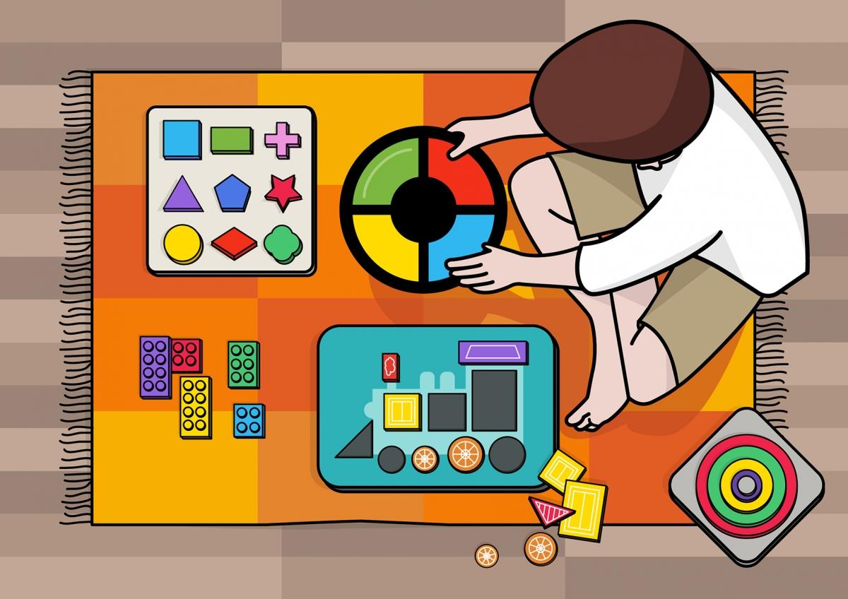 Un niño juega en la alfombra con sus juguetes