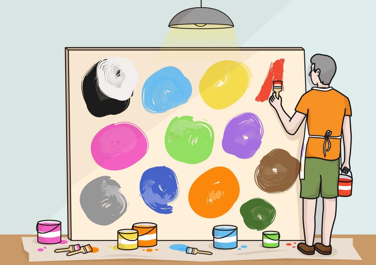 Imagen en la que una persona está pintando con colores en un lienzo