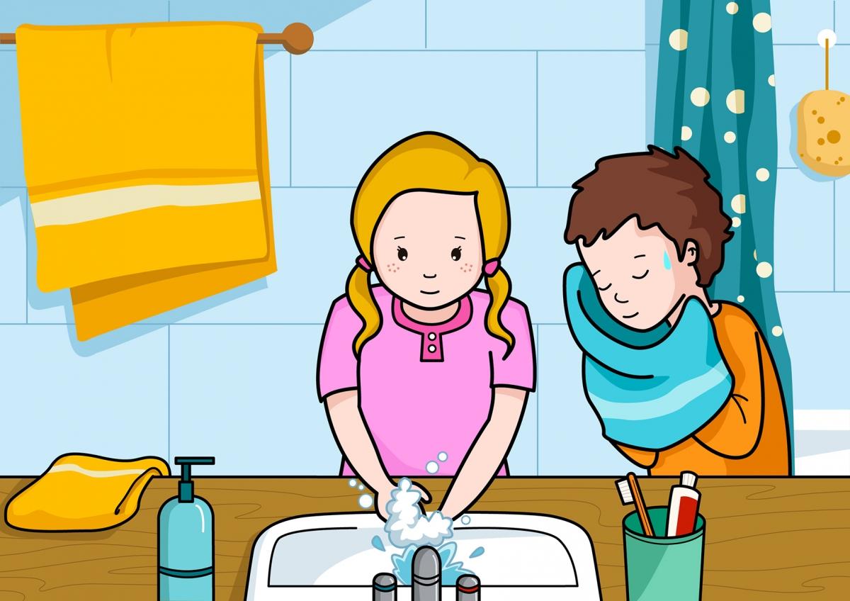La niña se lava las manos y el niño se seca la cara