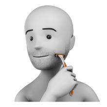 Imagen en la que se ve una persona afeitándose la barba con una cuchilla de afeitar