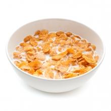 Imagen en la que se ve un bol lleno de cereales con leche