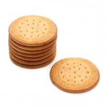 Imagen en la que se ve un montón de galletas apiladas y una galleta suelta a su derecha