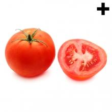 Imagen en la que se ve un tomate entero y a su derecha medio