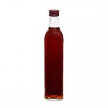 Imagen en la que se ve una botella de vinagre