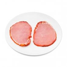 Imagen en la que se ve un plato con dos filetes de lomo adobado