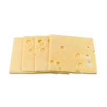 Imagen en la que se ven unas lonchas de queso