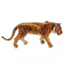 Imagen en la que se un tigre en perspectiva lateral