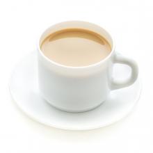 Imagen en la que se ve una taza con café con leche