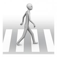 Imagen en la que se ve a una persona cruzando la calle