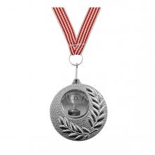 Imagen en la que se ve una medalla de plata