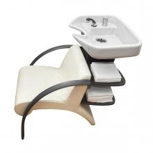 Imagen en la que se ve una silla lavacabezas de peluquería