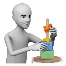 Persona jugando con un juego de encajables