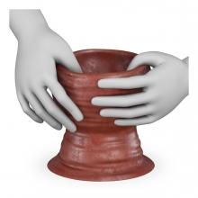 Imagen en la que se ven unas manos modelando una figura de barro