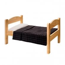 Imagen en la que se ve una cama de madera individual