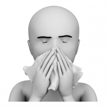 Imagen de una persona sonándose la nariz