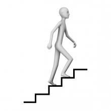 Imagen en la que aparece una persona subiendo las escaleras