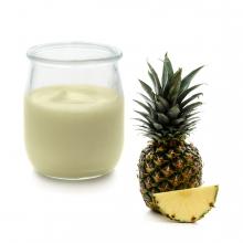 Imagen en la que se ve un yogur de piña